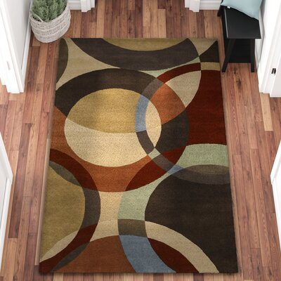 Dewald Chocolate/Red Area Rug Rug Size: Rectangle 5' x 8'