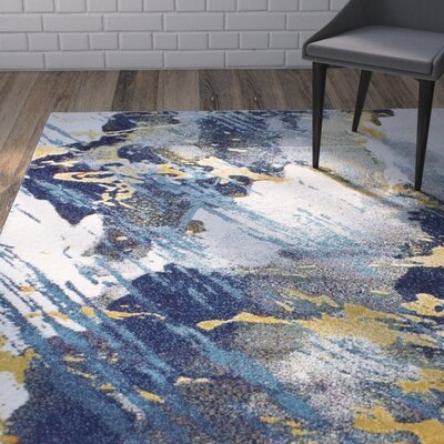 Reasor Ivory/Blue Area Rug Rug Size: Rectangle 76 x 96