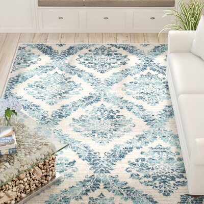 Delana Traditional Faded Oriental Dark Blue/Teal Area Rug Rug Size: Rectangle 710 x 103