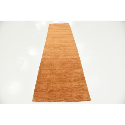 Taul Hand-Knotted Wool Orange Area Rug Rug Size: 2 7 x 9 10