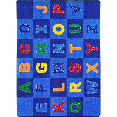 Altitude Patchwork Letters Blue Area Rug Rug Size: 54 x 78