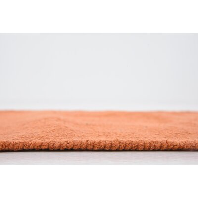 Arthurson Hand woven Wool Orange Area Rug