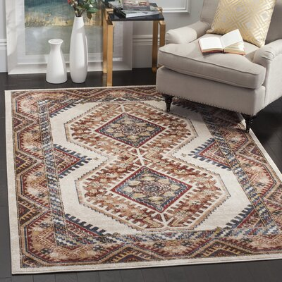 Isanotski Ivory/Rust Area Rug Rug Size: Rectangle 53 x 76