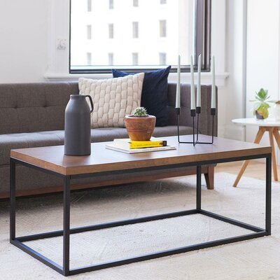 Renna Solid Wood Coffee Table Color: Dark Walnut