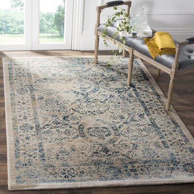 Ruthie Beige/Turquoise Area Rug Rug Size: Rectangle 51 x 76