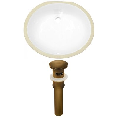 Ceramic Oval Undermount Bathroom Sink with Overflow Drain Finish: Antique Brass