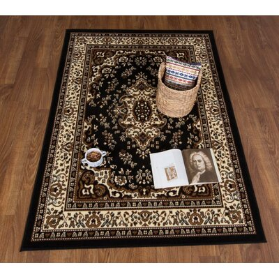 Dunlin Oriental Black/Beige Area Rug Rug Size: Rectangle 5 x 7
