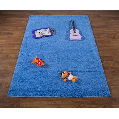 Washington Mews Shag Solid Blue Area Rug Rug Size: Rectangle 53 x 76