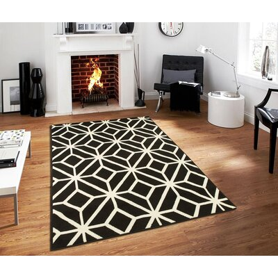 Pleione Black Indoor/Outdoor Area Rug Rug Size: Rectangle 5 x 8
