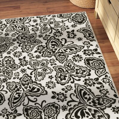 Stacy Ivory/Black Area Rug Rug Size: Rectangle 27 x 311