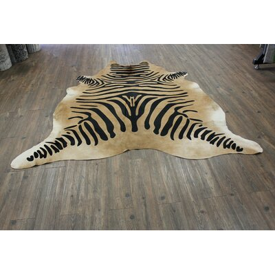 Ducote Stenciled Zebra Hair-on Hand-Woven Cowhide Black/Camel Area Rug
