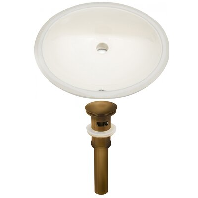 Ceramic Oval Undermount Bathroom Sink with Overflow Sink Finish: Biscuit, Drain Finish: Antique Brass