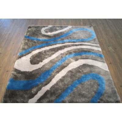 Clearwell Modern Hand-Tufted Blue Area Rug Rug Size: Rectangle 76 x 103