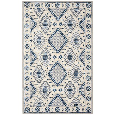 Celeste Hand-Tufted Wool Ivory/Blue Area Rug Rug Size: Rectangle 5 x 8