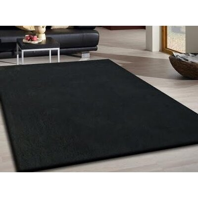 Heineman Solid Shag Hand-Tufted Black Area Rug Rug Size: Rectangle 76 x 103