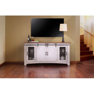 Pueblo TV Stand Color: White, Width of TV Stand: 70