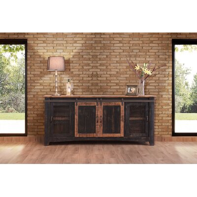 Pueblo TV Stand Color: Dark Brown, Width of TV Stand: 80