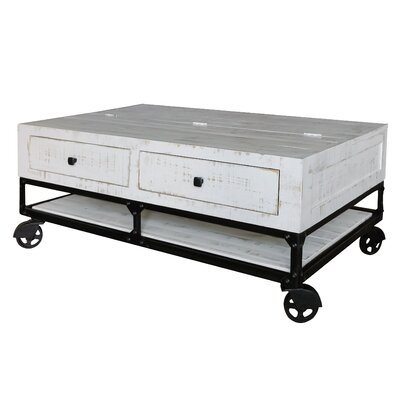 Zellner Coffee Table with 4 Drawer