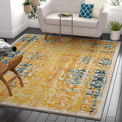 Binstead Traditional Medallion Distressed Power Loom Yellow Area Rug Rug Size: 23 x 311