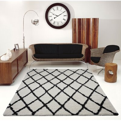 Fancy Trellis Ivory/Black Area Rug Rug Size: Rectangle 52 x 75
