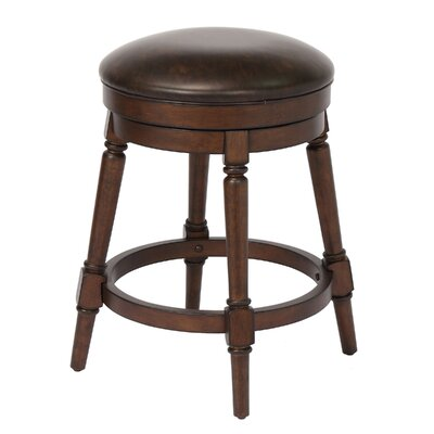 Almanzar 25 Swivel Bar Stool Frame Color: Walnut
