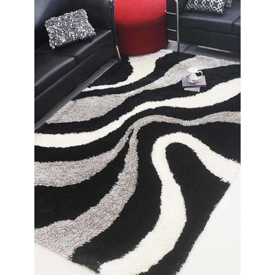 Henricks Hand-Tufted Black/Beige Area Rug