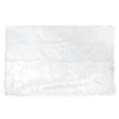 Ashton Faux Fur Backed to Suede White Area Rug Rug Size: Rectangle 4 x 6