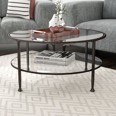 Casas Metal and Glass Round Coffee Table Color: Black
