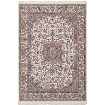 Hudgins Tabriz Cream Area Rug Rug Size: Rectangle 67 x 910