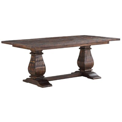 Puppis Extendable Dining Table