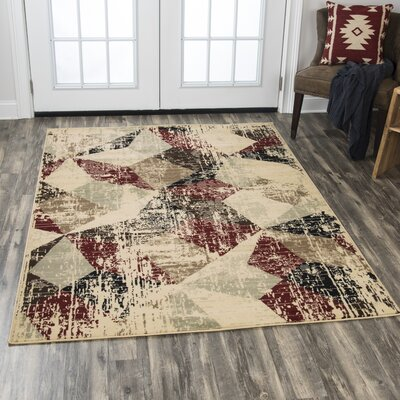 Minyard Beige/Red Area Rug Rug Size: Rectangle 52 x 73