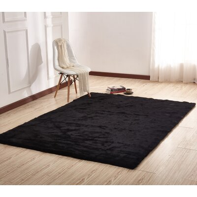Maire Hand-Tufted Black Area Rug