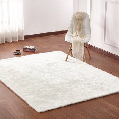 Margrett Hand-Tufted Off-White Area Rug