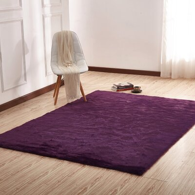 Makenna Hand-Tufted Dark Purple Area Rug