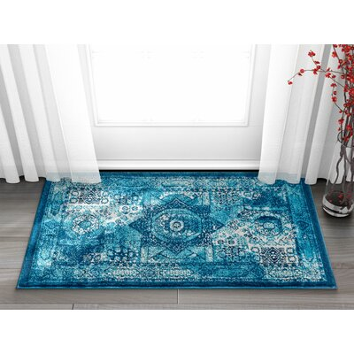 Osorio Vintage Over Dyed Medallion Center Blue Area Rug Rug Size: Rectangle 23 x 311