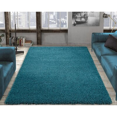 Yarborough Solid Design Contemporary Shag Turquoise Area Rug Rug Size: Rectangle 67 x 93