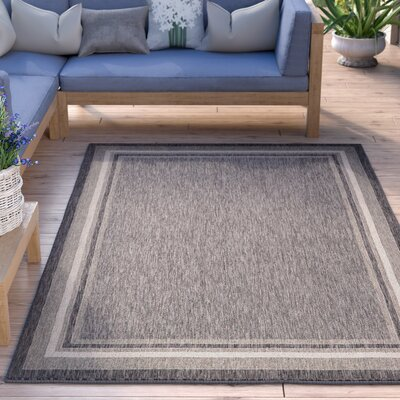 Kennedy Black Outdoor Area Rug Rug Size: Rectangle 4' x 6'