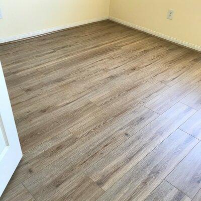 8 x 48 x 12mm Pine Laminate Flooring in Gainsbore