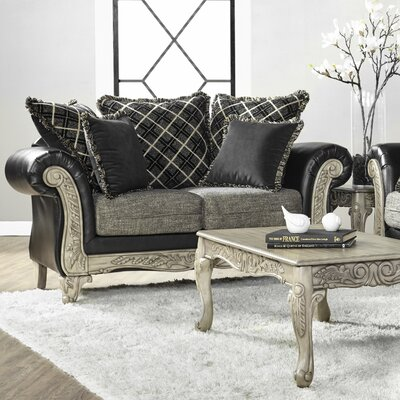 Meachum Ebony Loveseat