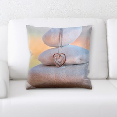 Blakeley Jewelry on a Rock Throw Pillow
