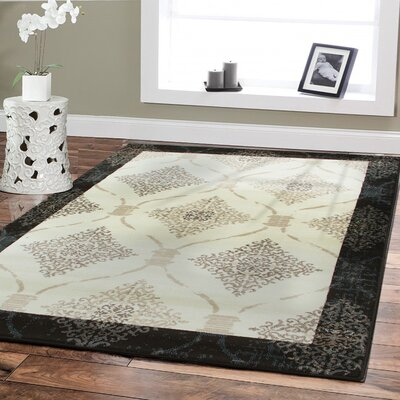 Baysden Distressed Ivory/Black Area Rug Rug Size: Rectangle 5 x 8