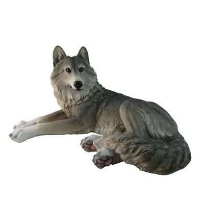Suter Wolf Laying Down Figurine 0A819B002D614840BAEE868BAD26D208