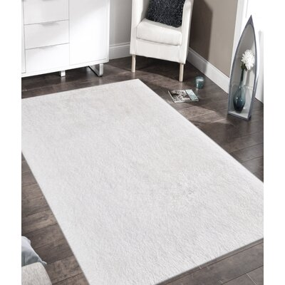 Doster Solid White Area Rug Rug Size: Rectangle 76 x 96