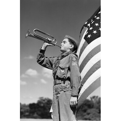 """'1950s Profile of Boy Scout in Uniform Standing in Front of 48 Star American Flag Blowing Bugle' Photographic Print on Wrapped Canvas Size: 12"""" H x 8"""" W x 0.75"""" D 9592B988AE354754B00A33581FA24DE3"""