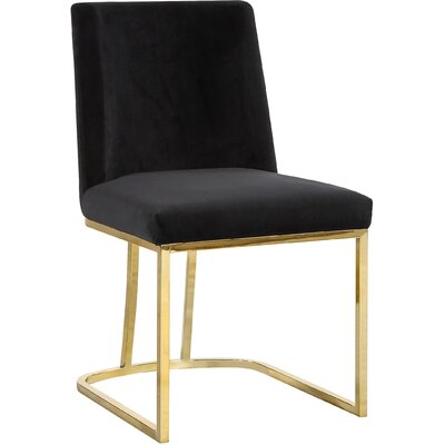 Seppich Upholstered Dining Chair Upholstery Color: Black