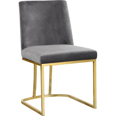 Seppich Upholstered Dining Chair Upholstery Color: Gray
