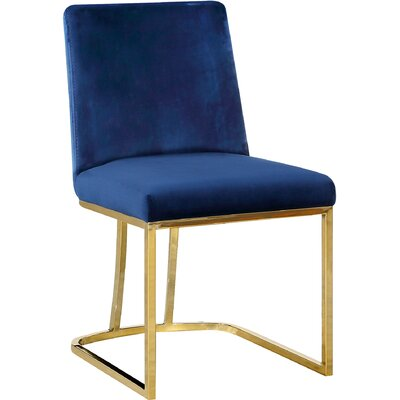 Seppich Upholstered Dining Chair Upholstery Color: Navy