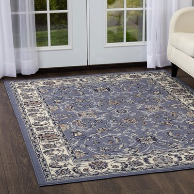 Lilly Traditional Border Blue/Ivory Area Rug Rug Size: Rectangle 52 x 74