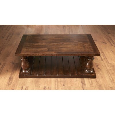 Dickens Four Column Coffee Table Size: 20.5 H x 54 W x 30 D, Color: Pecan