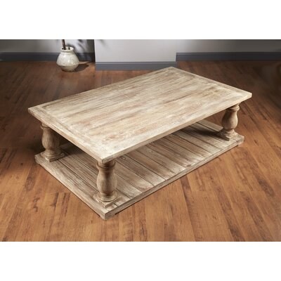 Dickens Four Column Coffee Table Size: 20.5 H x 68 W x 40 D, Color: Sand